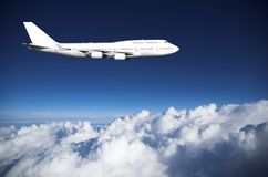 Jumbo jet  above clouds Stock Photo