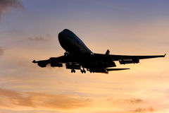 Jumbo jet airliner approaches landing. Silhouette of jumbo jet approaching landing Stock Images