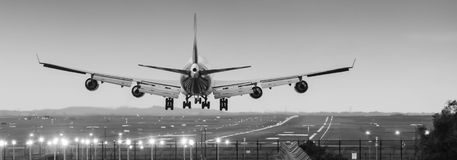 Jumbo jet airliner landing on runway. Boeing 747 jumbo jet airliner about to land at airport Stock Photography