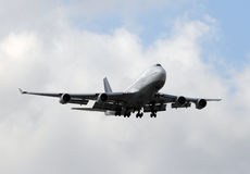 Jumbo jet approaching Stock Image