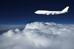 Jumbo jet in evening sky Stock Image