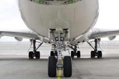 A jumbo jet head on with its wheels and nose Stock Images