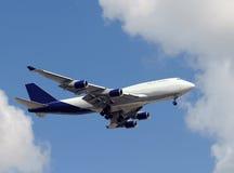 Jumbo jet landing Stock Images