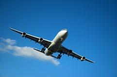 Jumbo jet landing Stock Image