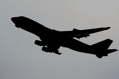 Jumbo jet silhouette Stock Images