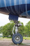 Jumbo nose landing gear of aircraft Stock Photos