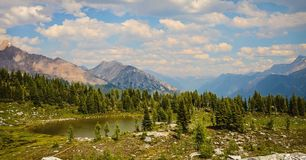 Jumbo Pass hiking trail and tarn, British Columbia, Canada. Purcell Mountains landscape stock images