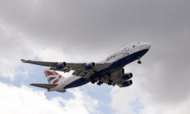 Jumbo 747 passenger jet with landing gear down Stock Photo