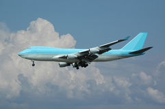 Jumbo plane and clouds stock image