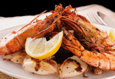 Jumbo prawns and grilled squids with black rice Royalty Free Stock Images