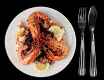 Jumbo prawns and grilled squids with black rice Royalty Free Stock Image