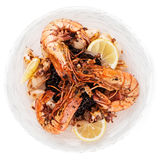 Jumbo prawns and grilled squids with black rice isolated on whit Royalty Free Stock Photography
