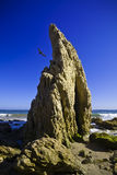 Jumbo rock in Malibu beach Stock Photography