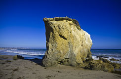Jumbo rock in Malibu beach Royalty Free Stock Photography