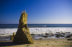 Jumbo rock in Malibu beach Stock Images