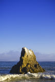 Jumbo rock in Malibu beach Royalty Free Stock Image