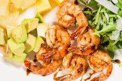 Jumbo shrimp salad with avocado mango Stock Image