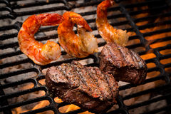 Jumbo Shrimp and Steak on a Grill Royalty Free Stock Image