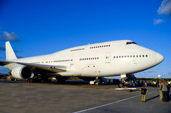 Jumbojet plane in airport Royalty Free Stock Image