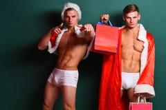 Jumeaux beaux de Santa de macho image libre de droits