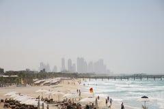 Jumeirah beach, Dubai. View of beach at Jumeirah with Dubai construction in background Stock Images