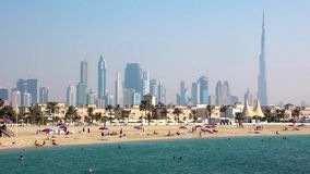 Jumeirah beach, Persian Gulf, Dubai downtown and Burj Khalifa, United Arab Emirates stock video