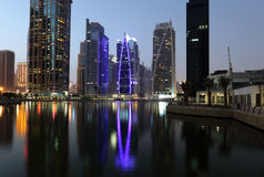 Jumeirah Lake Towers at night Stock Photos