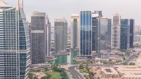 Jumeirah Lake Towers residential district aerial timelapse near Dubai Marina. Modern skyscrapers and park from above stock video