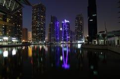 Jumeirah Lakes Towers at night Stock Photos
