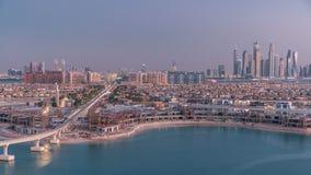 Jumeirah Palm island skyline day to night timelapse in Dubai, UAE.