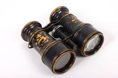 Jumelles antiques de vintage sur un fond blanc Images libres de droits