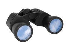Jumelles avec le ciel bleu réfléchi sur des lentilles Images libres de droits