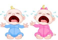 Jumelles pleurantes de chéri Photo stock