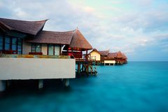 Villa Hotel Resort, Maldives tourist attractions. Panorama view of luxury Villas on Piles in ocean, sunrise stock photos