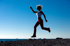 Juming Girl On The Beach While Running Stock Images