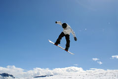 Jump. Snowboarder jump through big blue air Royalty Free Stock Photo