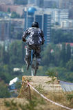 Jump. Of biker from springboard on background of the city Stock Photography