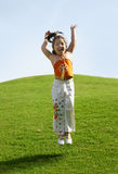 Jump!. Girl jumping up and down in the grass Royalty Free Stock Images