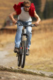 Jump. Of the biker through small barrier Royalty Free Stock Photo