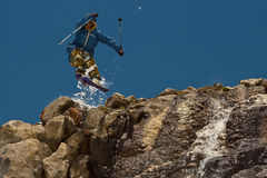 Jump. Freerider jumping in a mountains, Caucasus, Elbrus, summer Royalty Free Stock Photos