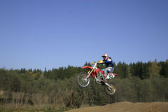 Jump. Motor bike. Jump on the course stock image
