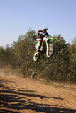 Jump. Motor bike. Jump on the course royalty free stock photography