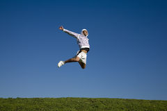 Jump. Healthy lifestyle: man training outdoors and jumping high Royalty Free Stock Photos