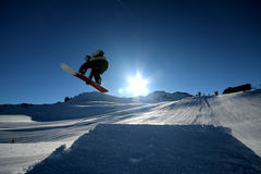Jump. A snowboarder takes flight in Whistler, BC Stock Photo