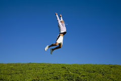 Jump. Healthy lifestyle: man training outdoors and jumping high Stock Photography