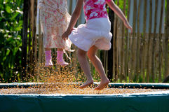 Jump! 2. Two girls are jumping on a trampoline Stock Photo