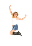 Jump. Young blond girl jumping of joy. White background Royalty Free Stock Photo