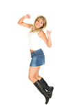 Jump. Young blond girl jumping of joy. White background Royalty Free Stock Photography