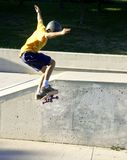 Jump. Teen skater doing a jump off a ramp Royalty Free Stock Images