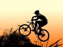 Jump!. Jump with a mountain bike and orange sunset Stock Photo